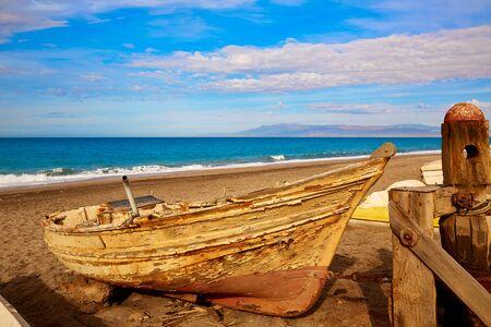 beached: Almeria Cabo de Gata beached boats in San Miguel beach of Spain