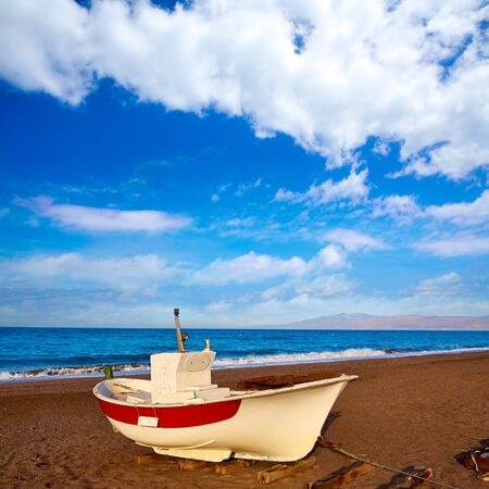 beached: Almeria Cabo de Gata San Miguel beach boats in Spain Stock Photo