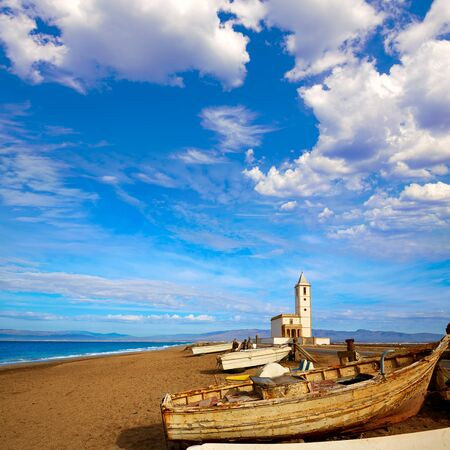 Cabo de Gata in Almeria at San Miguel Beach and Salinas church with stranded boats Stock Photo