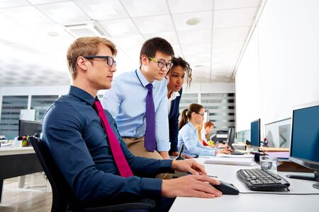 business consulting: Business team young people multi ethnic teamwork in office computer Stock Photo