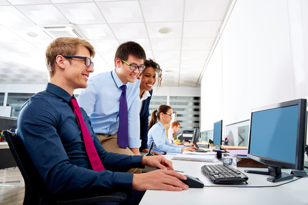 Business team young people multi ethnic teamwork in office computer Stock Photo