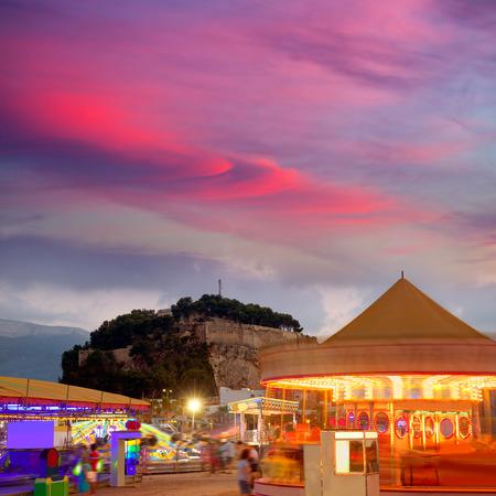 fairground: Denia in Alicante sunset with fairground fair at Spain Stock Photo