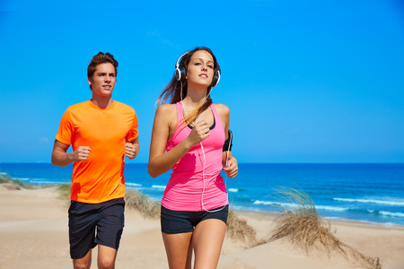 Couple young running in the beach in summer vacations Stock Photo