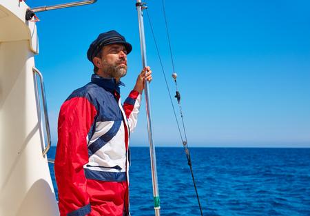 freshwater sailor: Beard sailor man sailing sea ocean in a boat with captain cap