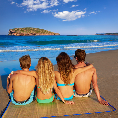 rear view girl: friends group couples sitting in beach sand rear view Ibiza photo mount