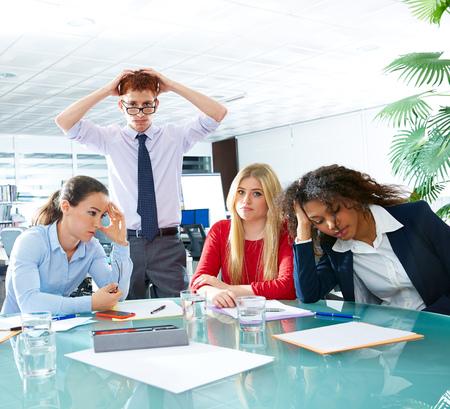 bad leadership: business meeting sad expression bad negative gesture young teamwork