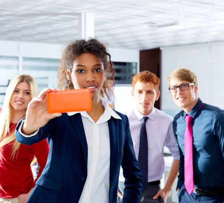selfy: African young executive selfy multi ethnic teamwork group as leader in office Stock Photo