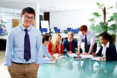 young executive: Asian executive young businessman portrait in office meeting