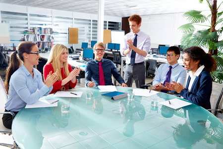 executive: Executive business team clapping hands in meeting at office multiracial people