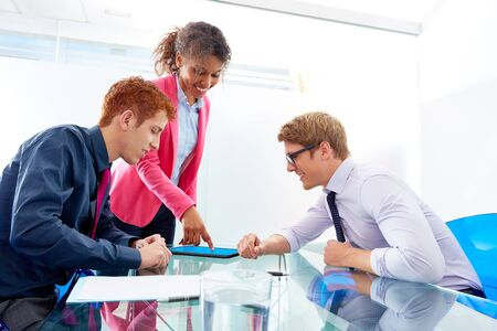 corporate office: Multi ethnic teamwork of young business people meeting working at office