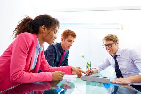 multi touch: Multi ethnic teamwork of young business people meeting working at office
