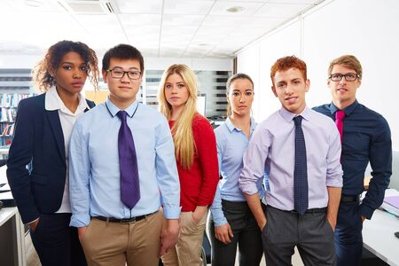 asian business team: Business team young people standing multi ethnic teamwork office