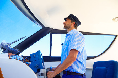 Captain cap sailor boating modern yacht boat indoor with beard