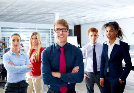 leader: Blond young businessman multi ethnic teamwork group as leader in office Stock Photo