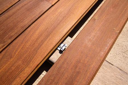 wood deck: Ipe teak decking deck wood installation clips fasteners Stock Photo