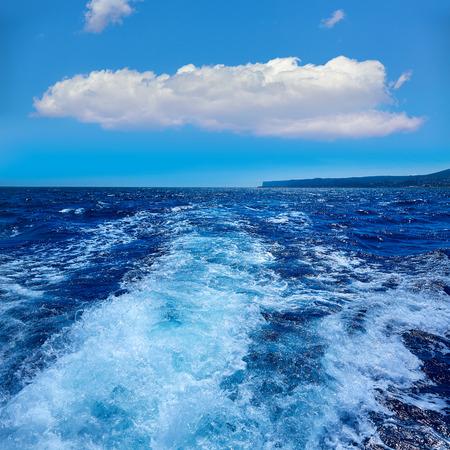 seaway: Denia San Antonio Cape in Alicante sailing with boat wake at Spain Stock Photo