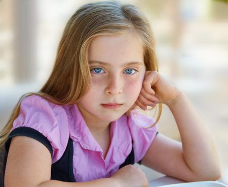 blonde  blue eyes: Blond relaxed sad kid girl expression blue eyes portrait
