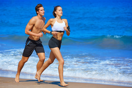 Couple young running in the beach in summer vacation
