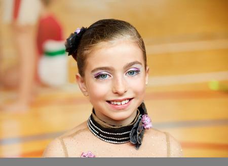 limber: kid girl rhythmic gymnastics on wooden deck portrait