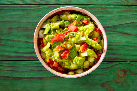 mexican food: Guacamole with avocado and tomatoes mexican food