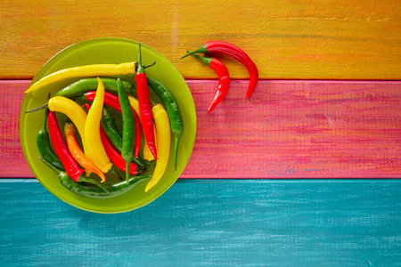spicy cooking: Colorful mexican chili peppers habanero red in wood table background