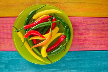 chilies: Colorful mexican chili peppers habanero red in wood table background