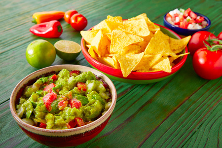 international food: Mexican food nachos guacamole pico de gallo and chili peppers sauces