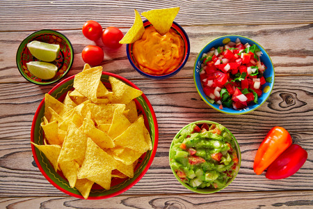 nachos: Mexican food mixed guacamole nachos chili sauce dipping cheddar cheese lemon pico de gallo