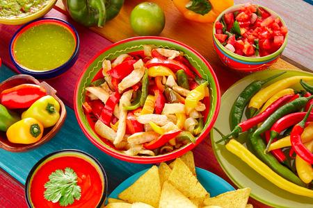 gallo: Chicken fajitas with mexican food guacamole pico de gallo chili peppers sauce and nachos