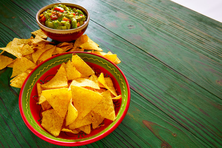 Guacamole with avocado tomatoes and nachos mexican food