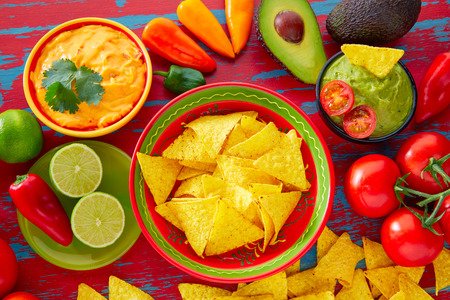 international food: Mexican food nachos and guacamole with chili peppers and sauces Stock Photo