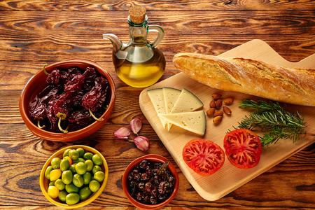 mediterranean food: Mediterranean food bread oil olives cheese peppers garlic almods rosemary