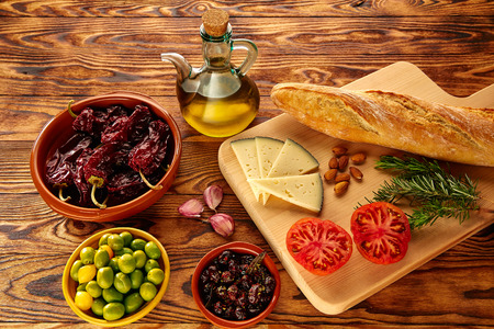 Mediterranean food bread oil olives cheese peppers garlic almods rosemary