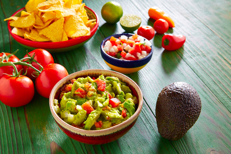 chips and salsa: Mexican food nachos guacamole pico de gallo and chili peppers sauces