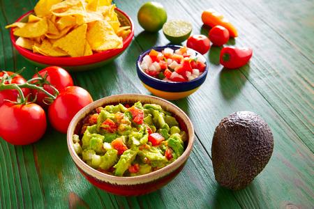 mexican food: Mexican food nachos guacamole pico de gallo and chili peppers sauces