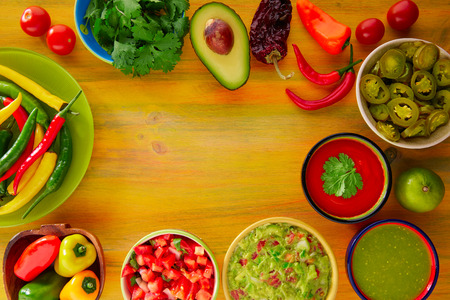 mexican: Mexican food mixed guacamole nachos chili sauce dipping cheddar cheese lemon pico de gallo