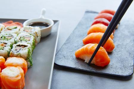 california roll: Sushi Maki and Niguiri with soy sauce and wasabi with California Roll
