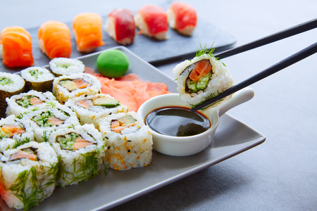 soy: Sushi Maki and Niguiri with soy sauce and wasabi with California Roll