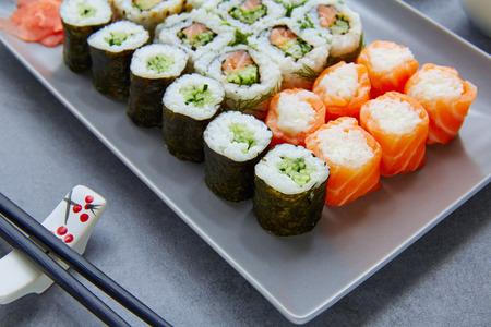 california roll: Sushi Maki and Niguiri with California roll and sticks Stock Photo