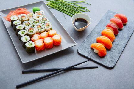 sushi plate: Sushi Maki and Niguiri California roll soy sauce and wasabi Stock Photo