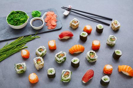 sushi: Sushi Maki and Niguiri California roll with seaweed chuka salad soy sauce and wasabi