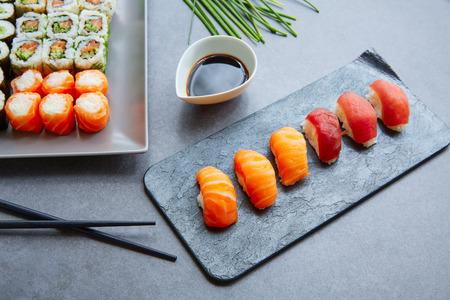 california roll: Sushi Maki and Niguiri with soy sauce and California roll