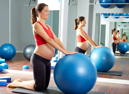 fitball: pregnant woman pilates fitball exercise workout at gym indoor Stock Photo