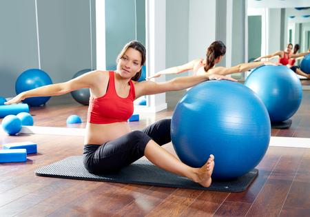 enceinte: pregnant woman pilates saw exercise workout at gym indoor Stock Photo