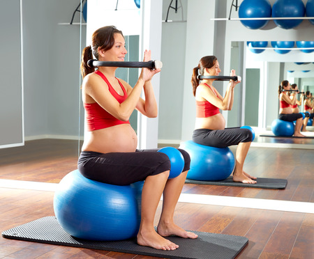 fitball: pregnant woman pilates exercise magic ring with fitball Stock Photo