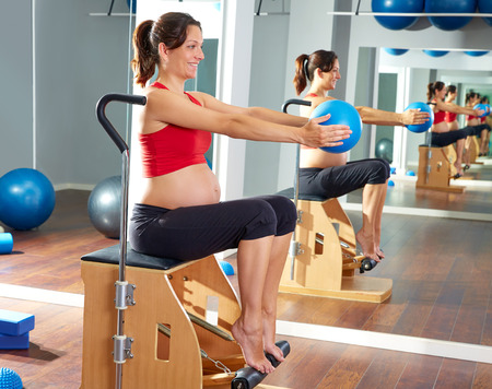 enceinte: pregnant woman pilates leg pumps exercise on wunda chair