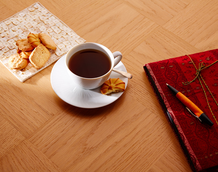 morning breakfast: Morning breakfast coffee with vintage red notebook and biscuits