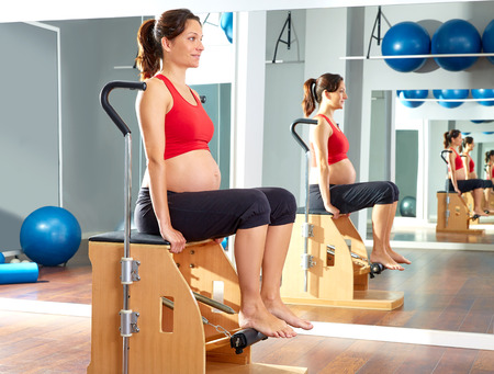 enceinte: pregnant woman pilates leg pumps exercise on wunda chair
