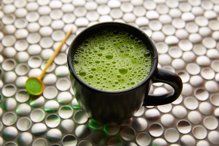 stainless steel background: Matcha green tea from Japan on modern stainless steel background