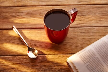breakfast cup: Coffee red cup newspaper morning breakfast on vintage wooden table